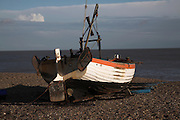 Small inshore fishing boat on the shingle beach, Aldeburgh, Suffolk, England