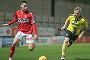 Stephen Walker of Middlesbrough (46) takes on Damien McCrory of Burton Albion (14) during the EFL Trophy group stage match between Burton Albion and U21 Middlesbrough at the Pirelli Stadium, Burton upon Trent, England on 7 November 2018.