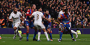 Marouane Chamakh, Wilfred Zaha and Mile Jedinak charge for the attack during the Barclays Premier League match between Crystal Palace and Swansea City at Selhurst Park, London, England on 28 December 2015. Photo by Michael Hulf.