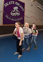 """Attached at the hip"" Gabrielle Isabelle, Maeghan Ash and Kellie Worster participate in the 24 hour Skate a Thon at Skate Escape to benefit the WLNH Children's Auction.   (Karen Bobotas/for the Laconia Daily Sun)"