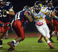 NEW HOPE, PA -  OCTOBER 25: Jenkintown's Alec Misinkavitch (41) is tackled by New Hope Solebury's Frank Covino (34) in the first half October 25, 2013 in New Hope, Pennsylvania.  (Photo by William Thomas Cain/Cain Images)