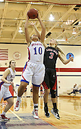 Washington Warrior's Aleena Hobbs (10) pulls in a rebound as Linn-Mar Lion's Hannah Yearling (3) tries to knock it away during their Regional Semi-Final game at Washington High School in Cedar Rapids on Saturday, February 16 2013.