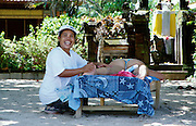 Jimbaran Beach. Guest having a massage at Keraton Bali Hotel.