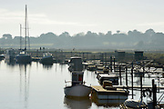 © Licensed to London News Pictures. 01/12/2013. Southwold, UK. The first of December was greeted by a brisk sunny morning at the harbour on the River Blyth in Southwold, Suffolk today, 1st December 2013. Photo credit : Stephen Simpson/LNP