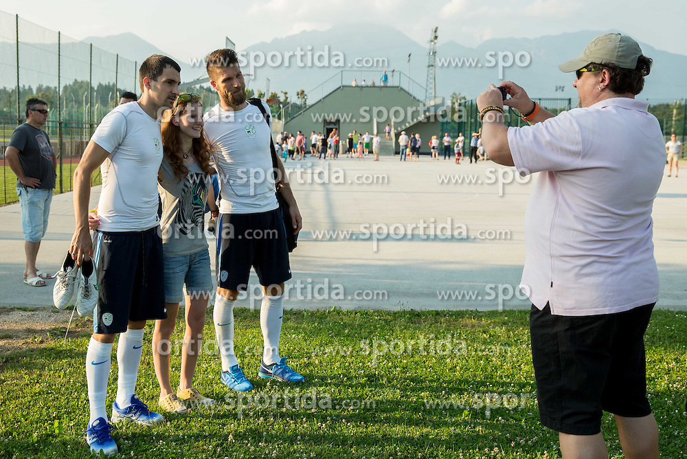 Branko Ilic and Bostjan Cesar with fan during practice session of Slovenian National Football Team before Euro 2016 Qualifications match against England, on June 10, 2015 in Kranj, Slovenia. Photo by Vid Ponikvar / Sportida