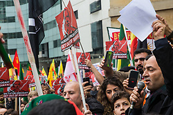 London, UK. 13 October, 2019. A Kurdish mayor addresses supporters of the YPG at a rally outside the BBC in protest against Turkey's invasion of Kurdish-held territory in north-eastern Syria.