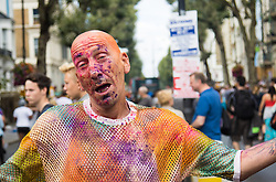 London, August 28th 2016. With many floats distributing coloured powder, some revellers cannot help but get covered during Europe's biggest street party, the Notting Hill Carnival.