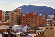 View of buildings in downtown Roanoke, Virginia with Mill Mountain in the background