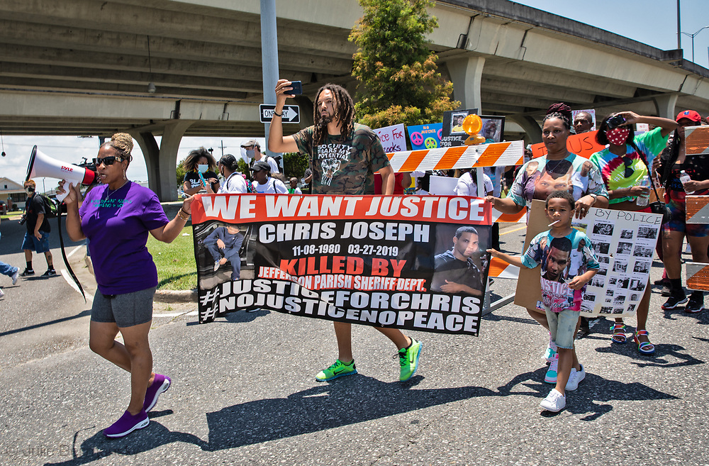 Protesters march during a protest organized by the families of Modesto Reyes, Keeven Robinson, Darivi Robertson,Chris Joseph, Armond Jairon Brown Eric Harris and Leo Brooks - black men killed by the Jefferson Parish Police since 2018, 5 people were arrested. Family members are calling for accountability from the Jefferson Parish Sheriff's Office and for the officers to be required to wear body cameras.