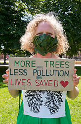 "© Licensed to London News Pictures;23/06/2020; Bristol, UK. Picture of KATIE WALLIS from the XR Bristol Arts Group wearing a mask with oak leaves that she made. Extinction Rebellion's Five a Week campaign for clean air stages a symbolic, theatrical action highlighting the number of premature deaths in Bristol due to air pollution. They have set up 5 cubes on College Green in front of City Hall with the message ""In Bristol, air pollution causes 5 deaths each week"". People are invited to take part and bring their own placard and message around air pollution and step on top of a cube for 2 minutes in silence, then allow the next person to take their place until the ""death count"" comes to 296. Participants are then invited to place their placards on the Green to create a sticking sea of messages. Social distancing measures are in place and everyone is required to participate wearing a mask. Extinction Rebellion demand urgent action from Bristol City Council & WECA (West of England Combined Authority) to protect people's lungs and protect the planet, saying health is intrinsically linked to the health of the environment. XR want Clean Air Equality for Life, not just for the coronavirus Covid-19 lockdown, saying we have a unique opportunity as we come out of lockdown to envision a Bristol that puts people's health and the health of the planet first, and put pressure on elected officials to help build the city back better. Photo credit: Simon Chapman/LNP."