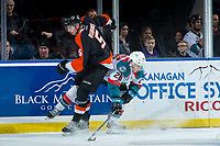 KELOWNA, CANADA - JANUARY 30: Kristians Rubins #5 of the Medicine Hat Tigers checks Leif Mattson #28 of the Kelowna Rockets on January 30, 2017 at Prospera Place in Kelowna, British Columbia, Canada.  (Photo by Marissa Baecker/Shoot the Breeze)  *** Local Caption ***