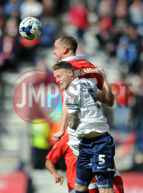 Bristol City's Aaron Wilbraham challenges for the header with Preston North End's Tom Clarke - Photo mandatory by-line: Dougie Allward/JMP - Mobile: 07966 386802 - 11/04/2015 - SPORT - Football - Preston - Deepdale - Preston North End v Bristol City - Sky Bet League One