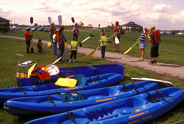 Stock photo of kayaks lined up as participants familiarize themselves with the equipment