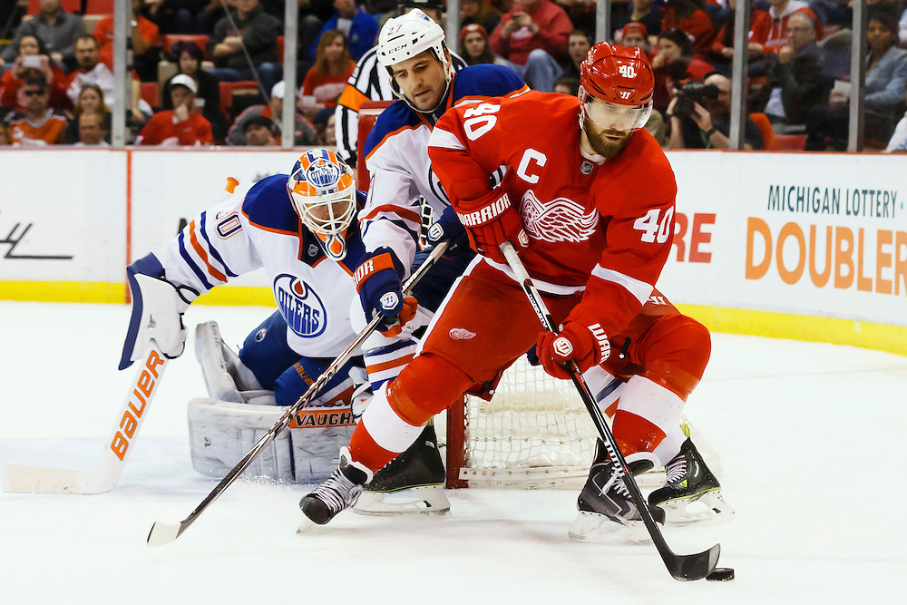 Mar 9, 2015; Detroit, MI, USA; Detroit Red Wings left wing Henrik Zetterberg (40) skates with the puck in front of Edmonton Oilers center Boyd Gordon (27) and goalie Ben Scrivens (30) in the third period at Joe Louis Arena. Detroit won 5-2. Mandatory Credit: Rick Osentoski-USA TODAY Sports