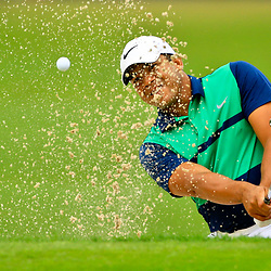 May 2, 2016; Avondale, LA, USA; Jhonattan Vegas hits from the sand on the 18th hole during the third round of the 2016 Zurich Classic of New Orleans at TPC Louisiana. The tournament has been shortened to 54 holes due to weather delays throughout the week. Mandatory Credit: Derick E. Hingle-USA TODAY Sports