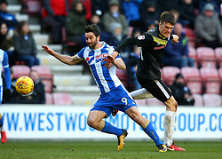 Will Grigg of Wigan Athletic is fouled by Ryan Delaney of Rochdale - Mandatory by-line: Robbie Stephenson/JMP - 24/02/2018 - FOOTBALL - DW Stadium - Wigan, England - Wigan Athletic v Rochdale - Sky Bet League One