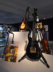 A guitar owned by Prince (front) and a guitar owned by Jimi Hendrix (centre back) on display ahead of the the Entertainment Memorabilia Sale at Bonhams in Knightsbridge, London later this week.