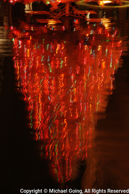 Water reflection Christmas Tree in red lights