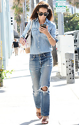 Double denim! Katie Holmes highlights svelte physique in ripped jeans as she grabs coffee-to-go during spot of shopping. 04 Aug 2017 Pictured: Katie Holmes. Photo credit: MEGA TheMegaAgency.com +1 888 505 6342