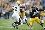 17 NOVEMBER 2007: Western Michigan running back Brandon West (2) cuts back as Iowa linebacker Jacody Coleman (55) runs past in Western Michigan's 28-19 win over Iowa at Kinnick Stadium in Iowa City, Iowa on November 17, 2007.