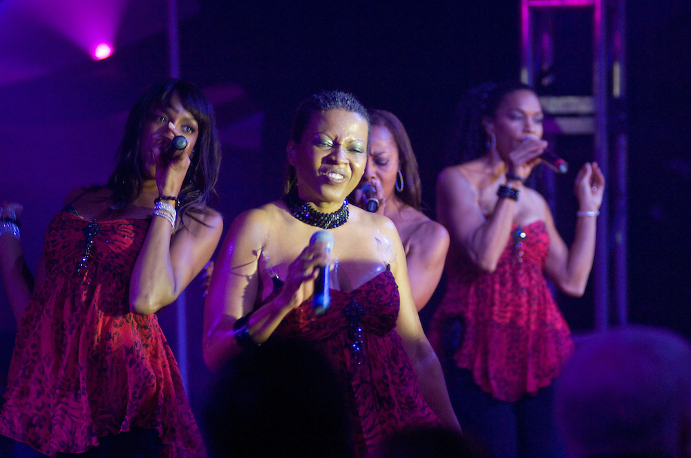 Ladies singing on stage for a performance