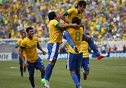 JUNE 09 2012:   Neymar (11) and Sandro (5) of Brazil congratulate Romulo (8) after he had scored the first goal during an international friendly match against Argentina at Metlife Stadium in East Rutherford,New Jersey. Argentina won 4-3.