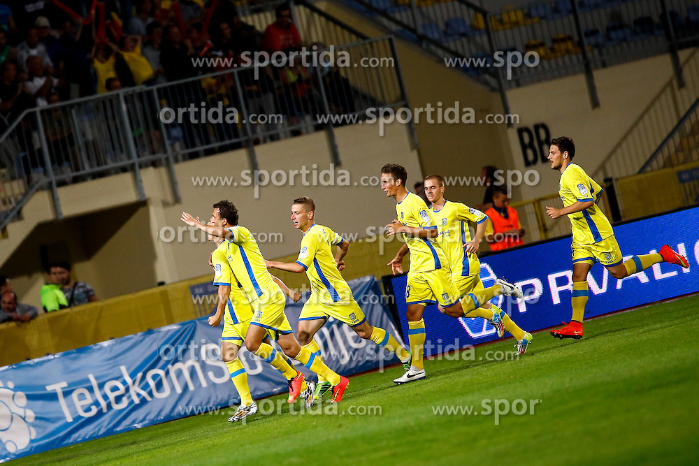 Players of Domzale celebrate after scoring a goal during football match between NK Domzale and NK Maribor in Round 7 of Prva Liga Telekom Slovenije 2014/15, on August 30, 2014 in Domzale, Slovenia. Photo by Matic Klansek Velej / Sportida.com