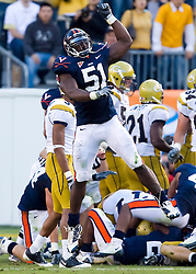 Virginia linebacker Clint Sintim (51) celebrates after his team recovered a Georgia Tech fumble in the second half.  The Virginia Cavaliers defeated the #18 ranked Georgia Tech Yellow Jackets 24-17 in NCAA Division 1 Football at Bobby Dodd Stadium on the campus of Georgia Tech in Atlanta, GA on October 25, 2008.