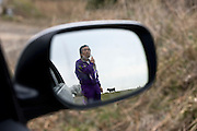 Former nuclear power plant worker Yuji Watanabe looks over cattleleft to fend for themselves at a farm in Minami-Soma, Fukushima Prefecture, Japan on 30 March, 2011.  Photographer: Robert Gilhooly