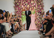 Designer Oscar de la Renta takes a bow with models Karlie Kloss, left, and Daria Strokous, right, after his Spring 2015 collection is modeled during Fashion Week in New York, Tuesday, Sept. 9, 2014.  (AP Photo/Diane Bondareff)