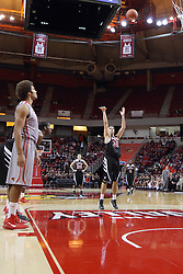 10 November 2014:  Reggie Lynch watches the free throw shot of Max Strus during an exhibition men's basketball game between Lewis University Flyers and the Illinois State Redbirds at Redbird Arena, Normal IL