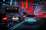 A long line of cars and buses inside the Lincoln Tunnel heading from Hoboken to Manhattan.