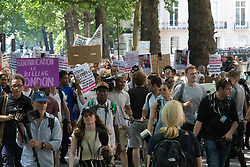 London, June 21st 2017. Protesters march through London from Sheherd's Bush Green in what the organisers call 'A Day Of Rage' in the wake of the Grenfell Tower fire disaster. The march is organised by the Movement for Justice By Any Means Necessary and coincides with the Queen's Speech at Parliament, the destination. PICTURED: The march progresses towards Notting Hill.