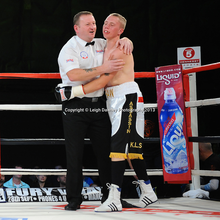 Referee Howard Foster consoles Martin Shaw after stopping the fight on Saturday 14th September 2013 at the Magna Centre, Rotherham. Hennessy Sports. Self billing applies. © Credit: Leigh Dawney Photography.