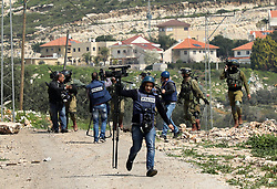 March 22, 2019 - Qalqilya, West Bank, 22th March 2019. Cashes occur between Palestinian demonstrators and the Israeli army in the West Bank town of Kafr Qaddum. Since 2003, the road between Kafr Qaddum and Nablus has been blocked to Palestinians and left open only to Israeli settlers and the Israeli army although an Israeli court ruled the roadblock illegal. The roadblock makes it impossible for Palestinians to reach their farmlands by car and lengthens the distance to Nablus of 14 Km. Up until 2013 Israel has confiscated 2,031 dunums of Kafer Qaddum agricultural land for the nearby Israeli settlements of Kedumim Zefon, Jit, and Giv'at HaMerkaziz, which are all part of the main Kedumin settlement. Weekly Friday demonstrations have been held since July 2011 to demand the reopening of the road to Nablus and against the expansion of the Kedumin settlement. Israeli settlements in the West Bank have been built and extended in contravention of international law (Credit Image: © Mohammed Turabi/IMAGESLIVE via ZUMA Wire)