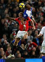 Photo: Steve Bond/Richard Lane Photography. Manchester United v Blackburn Rovers. Barclays Premiership 2009/10. 31/10/2009. Steven Nzoni (R) fouls Wes Brown (L)