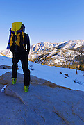 Backcountry skier enjoying the view below Piute Pass, Inyo National Forest, Sierra Nevada Mountains, California
