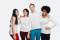 Portrait of multi-ethnic friends in casuals smiling over white background