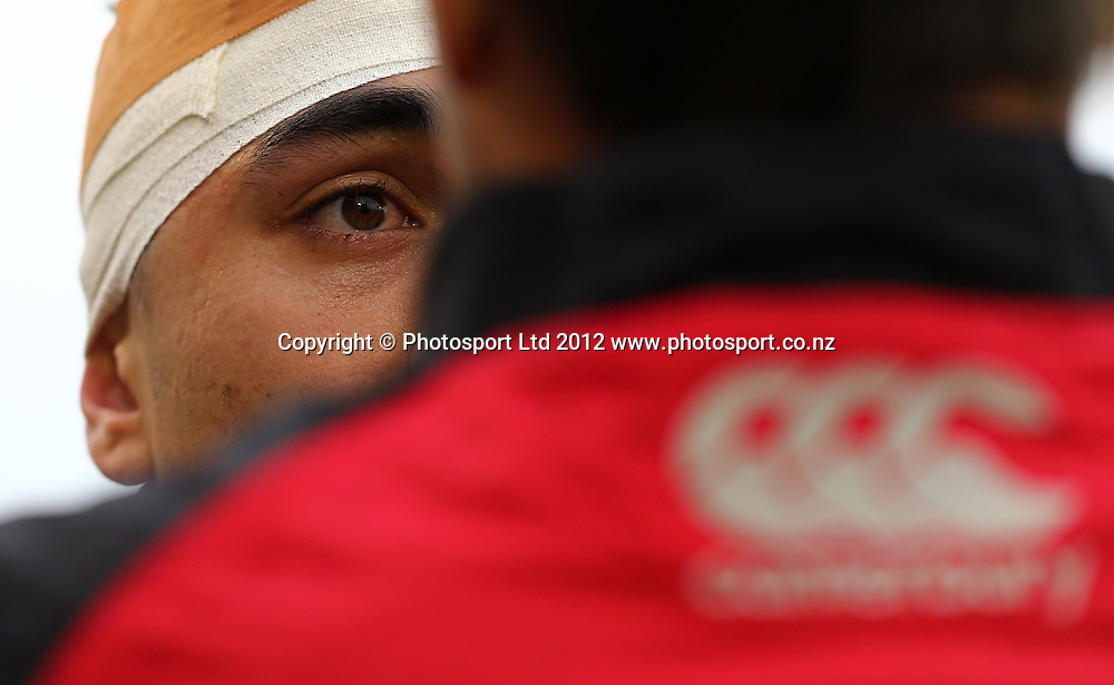 Shaun Johnson of the Warriors recieves the concussion test after a head wound during the NRL game, Vodafone Warriors v Penrith Panthers, Mt Smart Stadium, Auckland, Sunday 19 August  2012. Photo: Simon Watts /photosport.co.nz