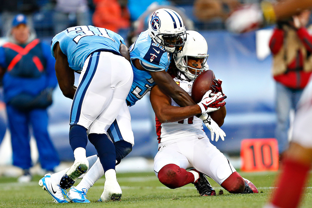 NASHVILLE, TN - DECEMBER 15: Larry Fitzgerald #11 of the Arizona Cardinals has the pass knocked away by Jason McCourty #30 of the Tennessee Titans at LP Field on December 8, 2013 in Nashville, Tennessee.  (Photo by Wesley Hitt/Getty Images) *** Local Caption *** Larry Fitzgerald; Jason McCourty