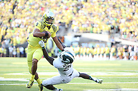 Oregon Ducks quarterback Marcus Mariota (8) runs to pass the ball during an NCAA college football game between the Oregon Ducks and the Michigan State Spartans, Saturday, Sept. 6, 2014, in Eugene, OR.(Tom Hauck)