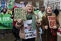 London, UK. 1st December, 2018. Environmental campaigners pass down Whitehall on the Together for Climate Justice demonstration in protest against Government policies in relation to climate change, including Heathrow expansion and fracking. Following a rally outside the Polish embassy, chosen to highlight the UN's Katowice Climate Change Conference which begins tomorrow, protesters marched to Downing Street.