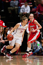 March 21, 2011; Stanford, CA, USA; Stanford Cardinal guard Toni Kokenis (31) dribbles past St. John's Red Storm guard Amanda Burakoski (11) during the first half of the second round of the 2011 NCAA women's basketball tournament at Maples Pavilion. Stanford defeated St. John's 75-49.