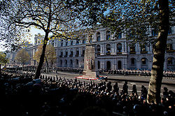 © London News Pictures. 11/11/2012. London, UK. Servicemen march down Whitehall during a Remembrance Day Ceremony at the Cenotaph on November 11, 2012 in London, United Kingdom. Photo credit: Ben Cawthra/LNP