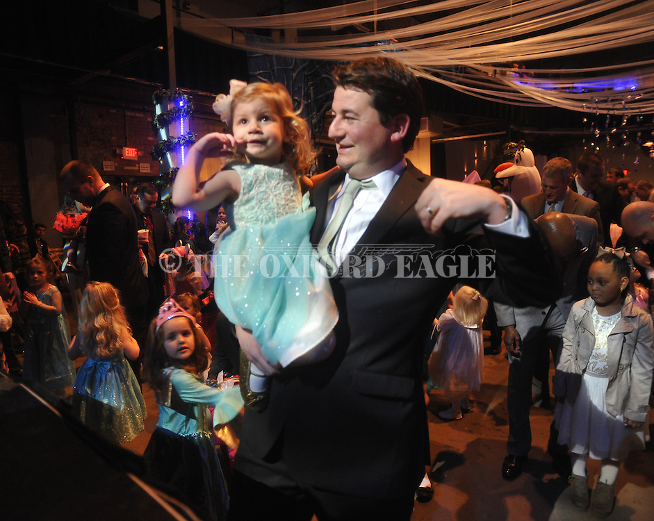 Scott Burton dances with his daughter Katie Grace at the Princess Ball at the Lyric in Oxford, Miss. on Monday, February 9, 2015.