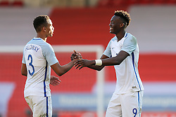 Brendan Galloway is congratulated by Tammy Abraham of England U21 after a 5-0 win - Rogan Thomson/JMP - 11/10/2016 - FOOTBALL - Bescot Stadium - Walsall, England - England U21 v Bosnia and Herzegovina - UEFA European Under 21 Championship Qualifying.