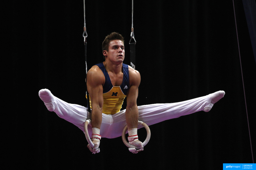 Sam Mikulak, Ann Arbor, Michigan, in action on the Still Rings during the Senior Men Competition at The 2013 P&G Gymnastics Championships, USA Gymnastics' National Championships at the XL, Centre, Hartford, Connecticut, USA. 16th August 2013. Photo Tim Clayton