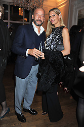 Footballer GIANLUCA VIALLI and his wife CATHRYN at a champagne reception to launch The Big Egg Hunt presented by Faberge in aid of the charities Action for Children and Elephant Family held at 29 Portland Place, London on 18th January 2012.