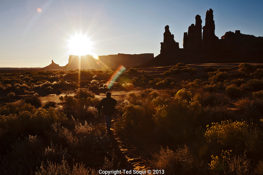 Totem Pole Rock inside the Monument Valley Tribal Park at sunrise. <br /> The Totem Pole was formed by erosion to the former butte.