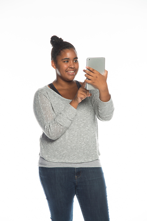 A student poses for a photograph, July 23, 2013.